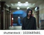 Guy In A Hood In The Street In...