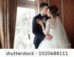 the bride and groom tenderly...   Shutterstock . vector #1020688111