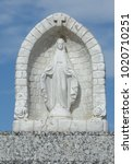 Small photo of Small statuette of Blessed Virgin Mary in alcove as memorial on gravestone