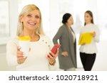 portrait of a happy mature... | Shutterstock . vector #1020718921
