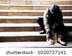 homeless man on walkway street...