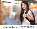 young student girl in library | Shutterstock . vector #1020728875