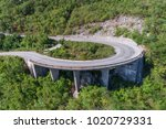 aerial view on road serpentine... | Shutterstock . vector #1020729331