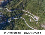 aerial view on road serpentine... | Shutterstock . vector #1020729355
