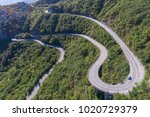aerial view on road serpentine... | Shutterstock . vector #1020729379