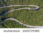 aerial view on road serpentine... | Shutterstock . vector #1020729385