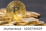bitcoin on wooden table top | Shutterstock . vector #1020734329
