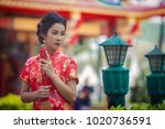 chinese girl wearing red dress... | Shutterstock . vector #1020736591
