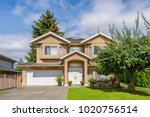 luxury house at sunny day in... | Shutterstock . vector #1020756514