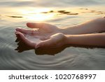 Woman Hands In Water Inviting...
