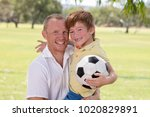 young happy father carrying on... | Shutterstock . vector #1020829891