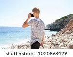 rear of teenager young man... | Shutterstock . vector #1020868429