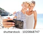portrait of son and mother... | Shutterstock . vector #1020868747