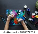 the artist's hands  paint... | Shutterstock . vector #1020877255