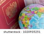 globe and russian passport ...   Shutterstock . vector #1020935251
