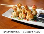 portion of six fried wontons on ...   Shutterstock . vector #1020957109