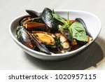 plate with mussels in a hot...   Shutterstock . vector #1020957115
