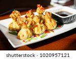 portion of six fried wontons on ...   Shutterstock . vector #1020957121