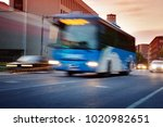 bus moving on the road in city... | Shutterstock . vector #1020982651