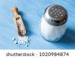 salt crystals with wooden spoon ... | Shutterstock . vector #1020984874