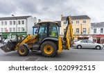 a jcb tractor in the city ...   Shutterstock . vector #1020992515