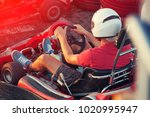 men driving go kart car with... | Shutterstock . vector #1020995947