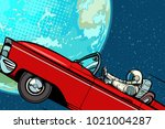 astronaut in a car over the... | Shutterstock .eps vector #1021004287