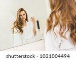 beautiful woman taking selfie... | Shutterstock . vector #1021004494