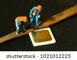damaged sim card and miniature...   Shutterstock . vector #1021012225