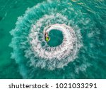 people are playing a jet ski in ... | Shutterstock . vector #1021033291