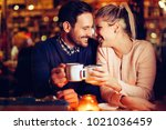 romantic couple dating in pub... | Shutterstock . vector #1021036459