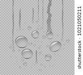 water droplets flow down on... | Shutterstock .eps vector #1021050211