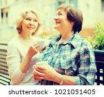 smiling elderly female friends... | Shutterstock . vector #1021051405