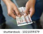 a man use his hand giving thai...   Shutterstock . vector #1021059379