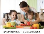 happy mother and her kids... | Shutterstock . vector #1021060555