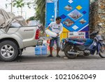 e man delivering bags of ice at ...   Shutterstock . vector #1021062049