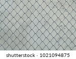Small photo of Metal cage surface isolated on cement floor. This route has cut routes.