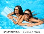 fashion women swimming in pool... | Shutterstock . vector #1021147531