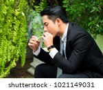 young businessman smoking and... | Shutterstock . vector #1021149031