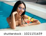summer pool fashion. woman with ... | Shutterstock . vector #1021151659