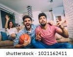 happy friends or basketball... | Shutterstock . vector #1021162411