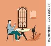 man having dinner in a... | Shutterstock .eps vector #1021165774