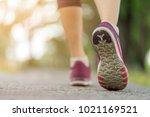 close up  sporty women shoe... | Shutterstock . vector #1021169521