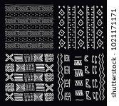 four white line art tribal... | Shutterstock .eps vector #1021171171