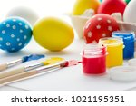 painting eggs for easter holiday | Shutterstock . vector #1021195351