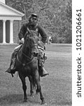 Small photo of DETROIT – AUGUST 10, 1979: antique horse soldier in a Dearborn park. Vintage picture taken in 1979.