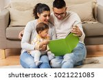 family  parenthood and people... | Shutterstock . vector #1021221085