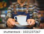close up hand of barista... | Shutterstock . vector #1021237267