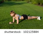 young woman making fitness...   Shutterstock . vector #102125884