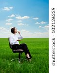 bright picture of young businesswoman with cup of coffee on the meadow - stock photo